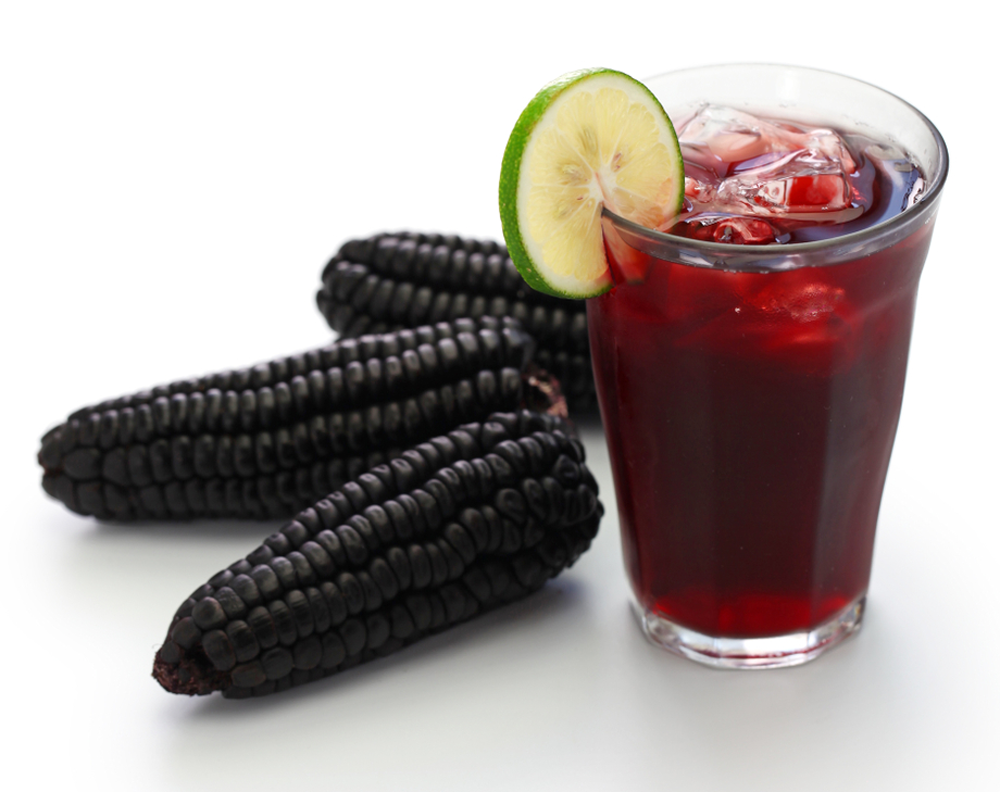 maiz morado and a glass of chicha morada with lime