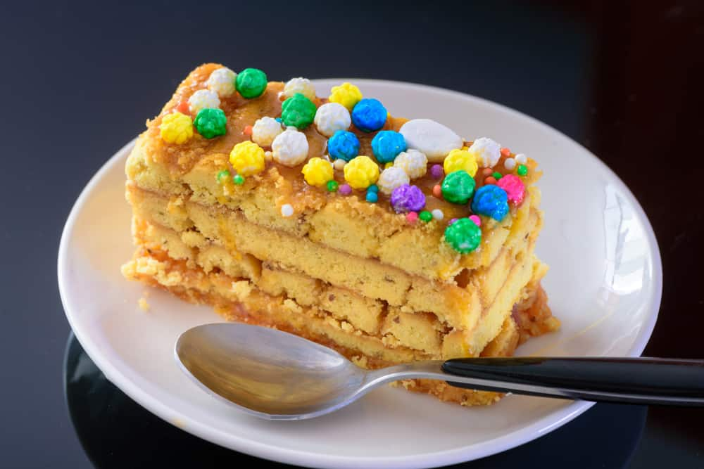Serving of Turron de Dona Pepa on a plate with fork