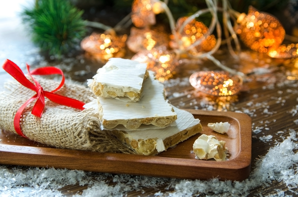 Christmas turron served on tray with Christmas ornaments
