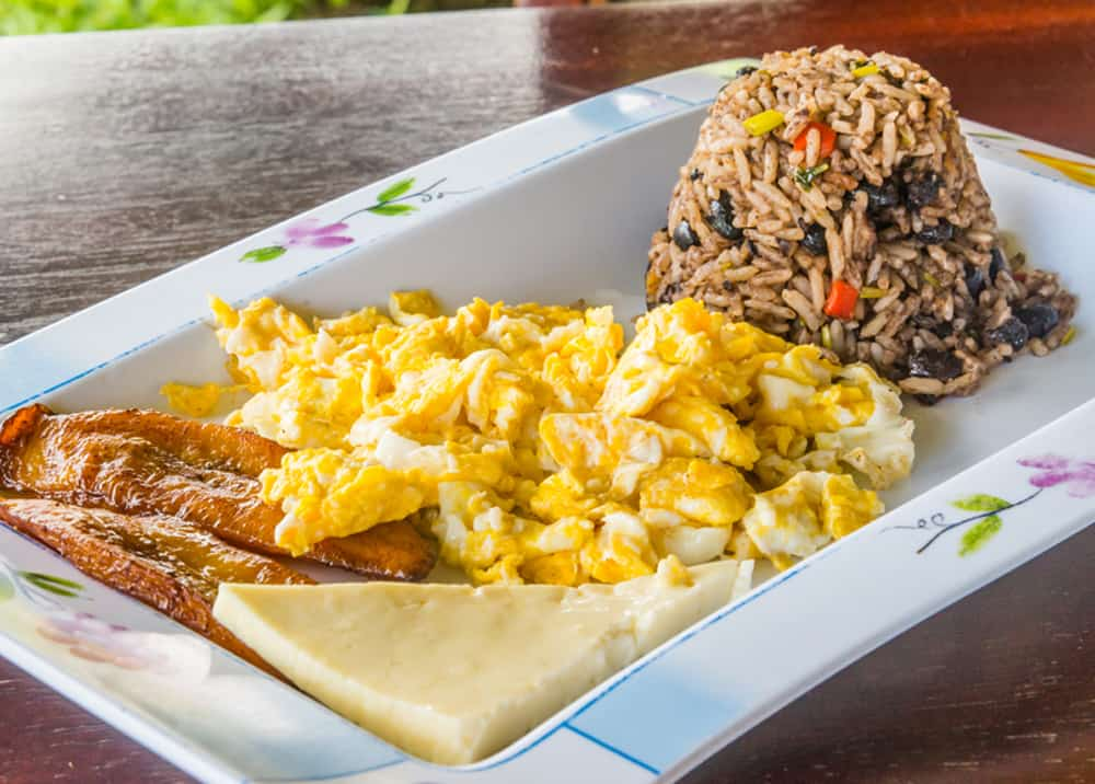 Gallo Pinto dish served with bacon eggs cheese
