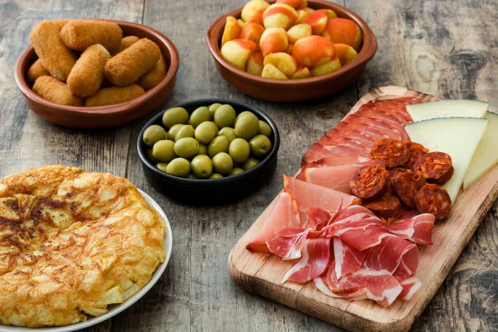 assorted Spanish tapas tortilla Española jamón serrano chorizo aceitunas croquetas papas