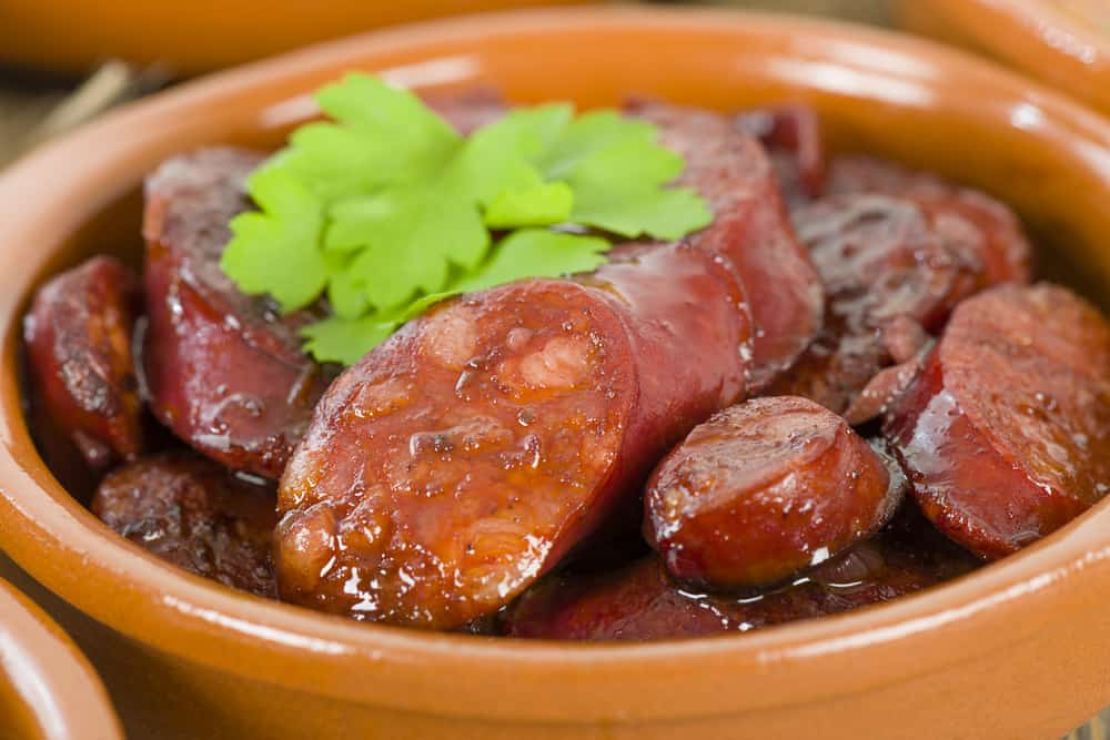 Spanish Chorizo al Vino served in a cazuela