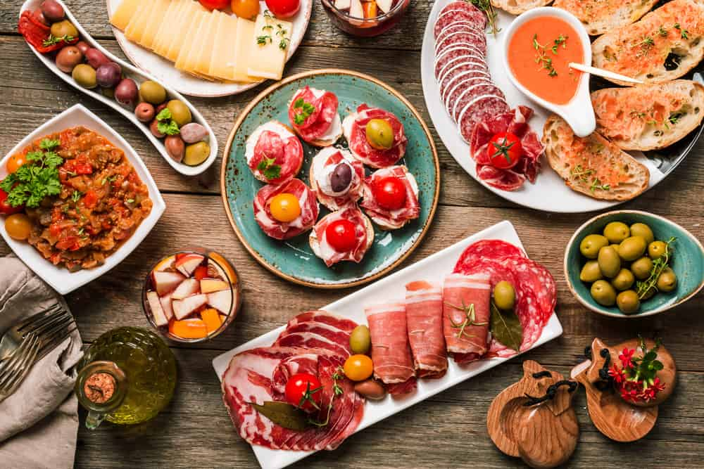 various plates of Spanish dishes