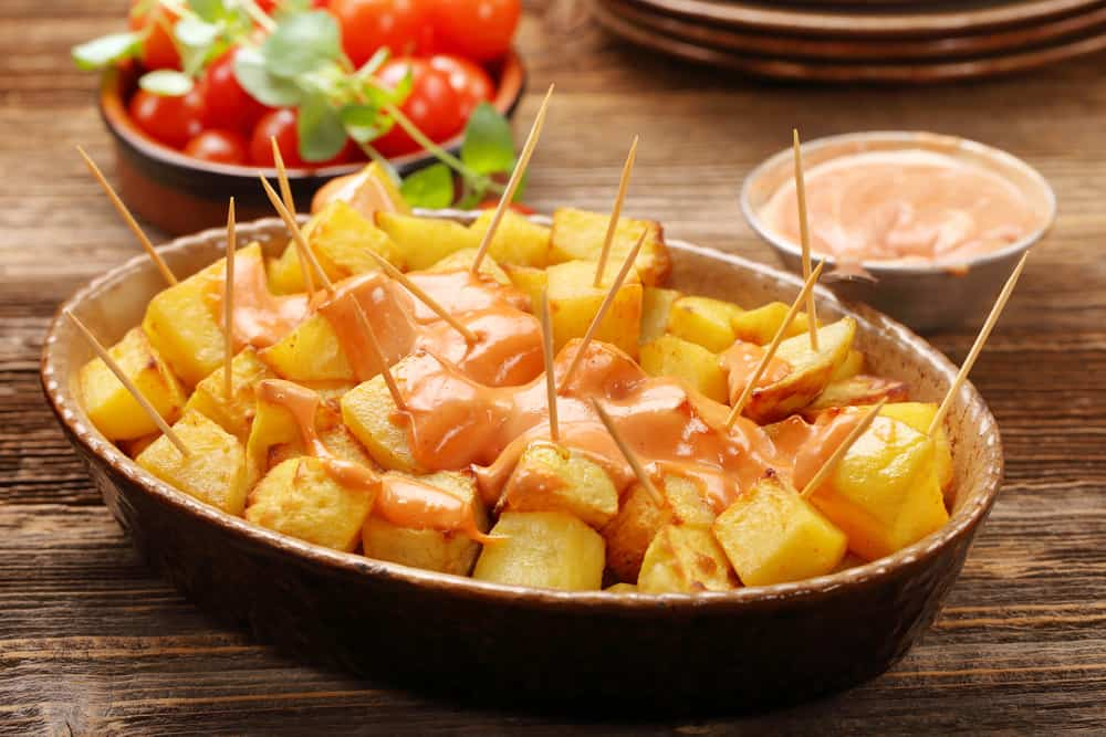 Plate of patatas bravas with Spanish sauce
