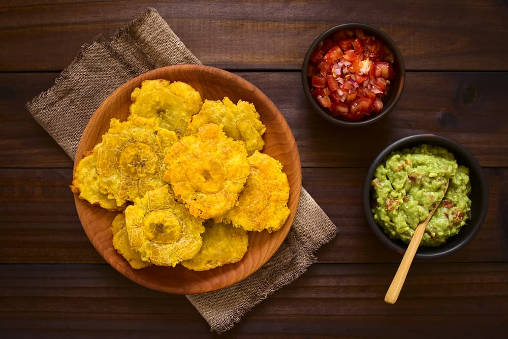 plate of tostones with dipping sauces