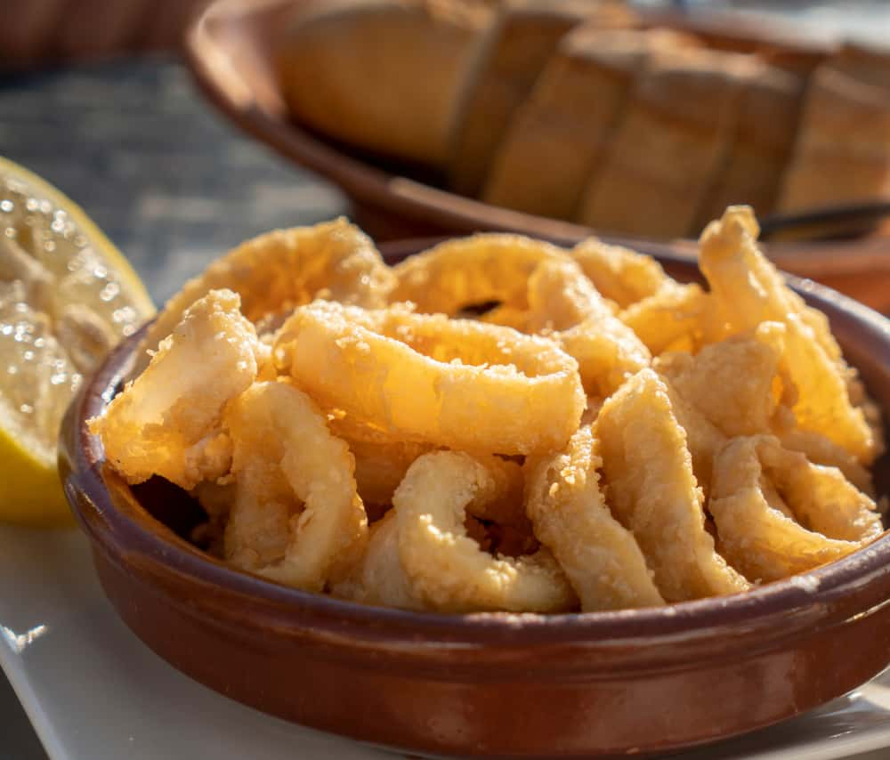 Spanish Calamares Fritos in a spanish cazuela bowl