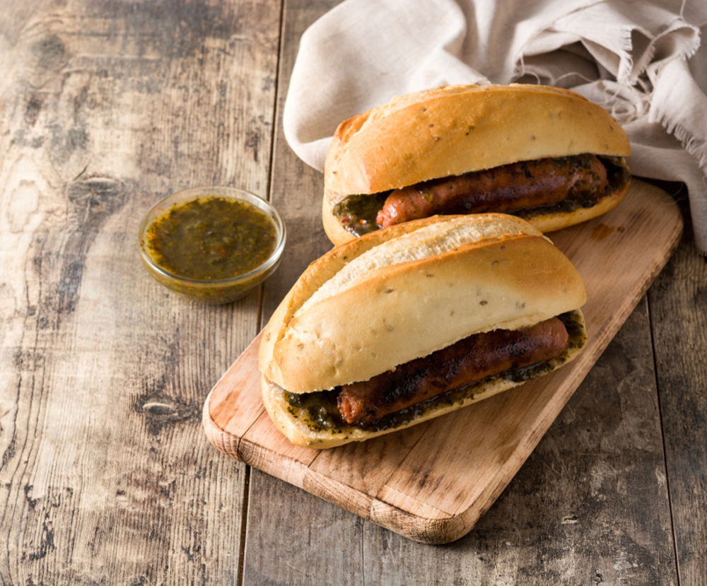 Two Choripan Argentinian Sandwiches with chimichurri sauce