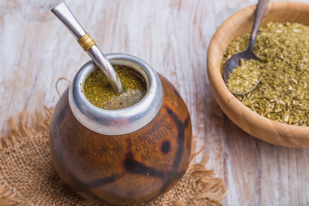 Yerba Mate Gourd wth bowl and bombilla and yerbaa mate tea