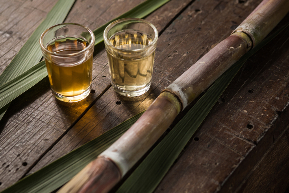 Two glasses of Cachaca and sugar cane