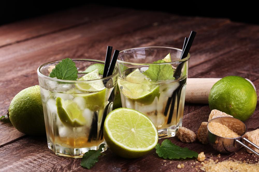 Two glasses of Caipirinha and sliced lime