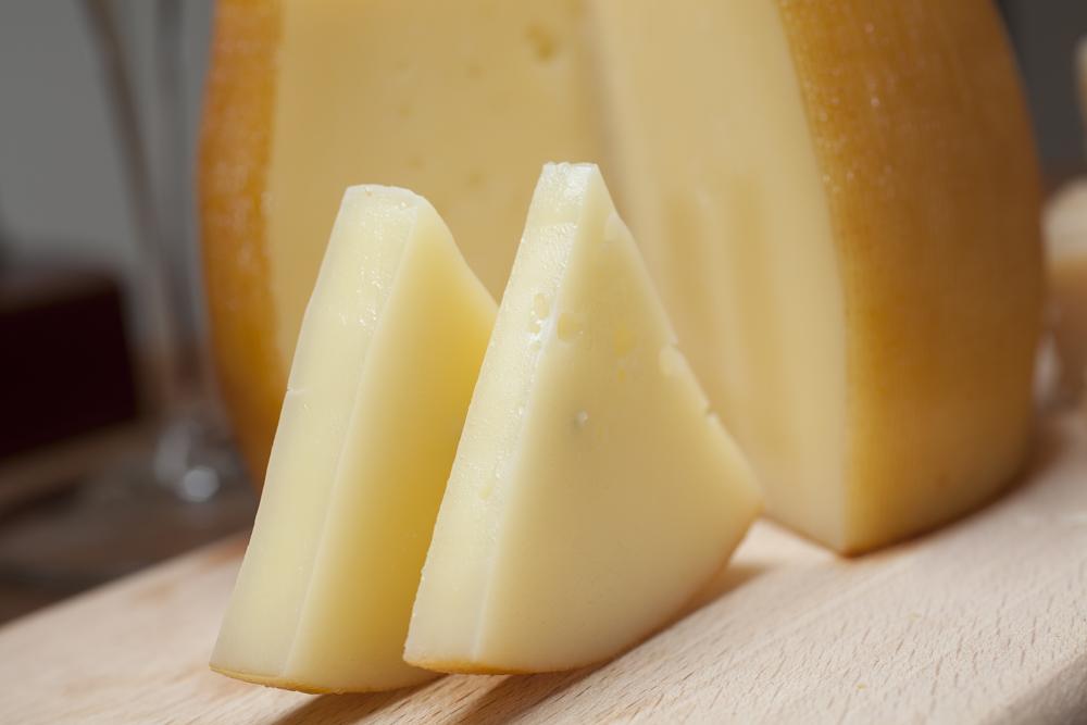 Sliced Idiazabal Cheese Wedges and wheel