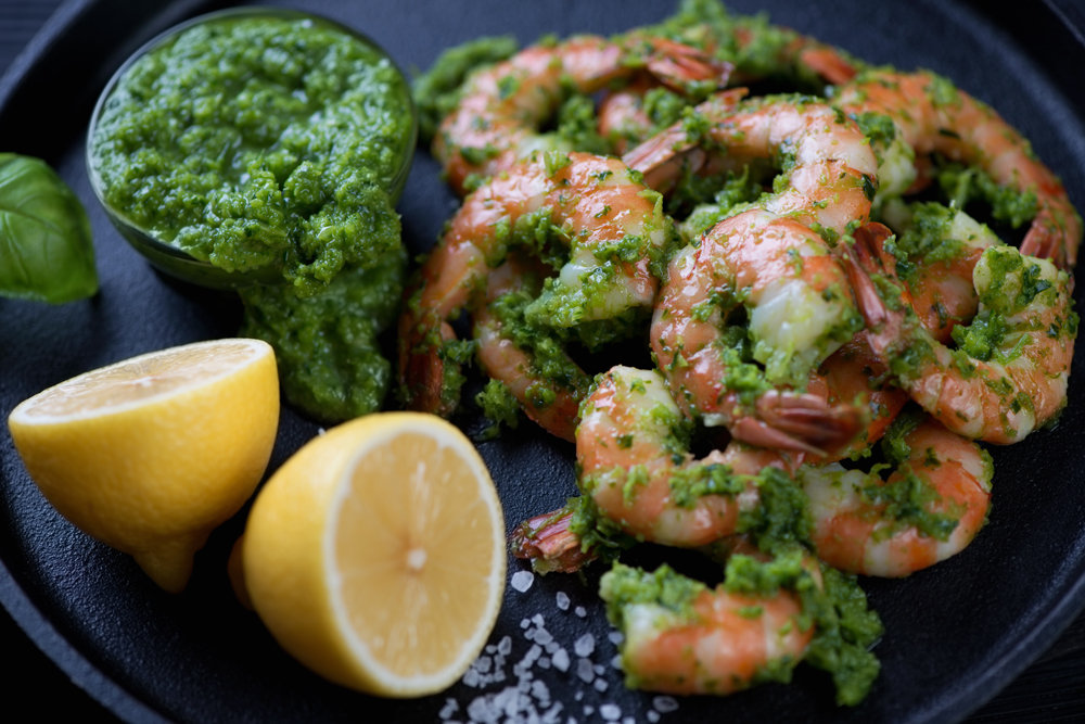 Chimichurri Sauce with lemon on tiger shrimp