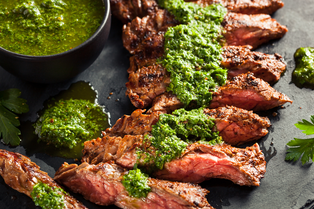 Chimichurri sauce on sliced skirt steak