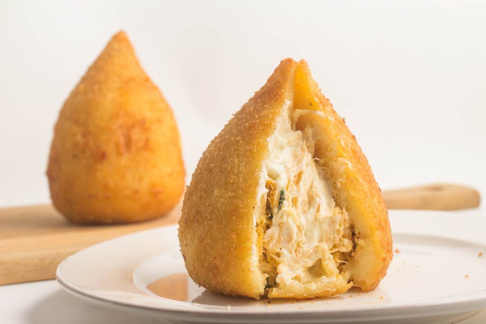 Coxinhas Brazilian served on a white plate