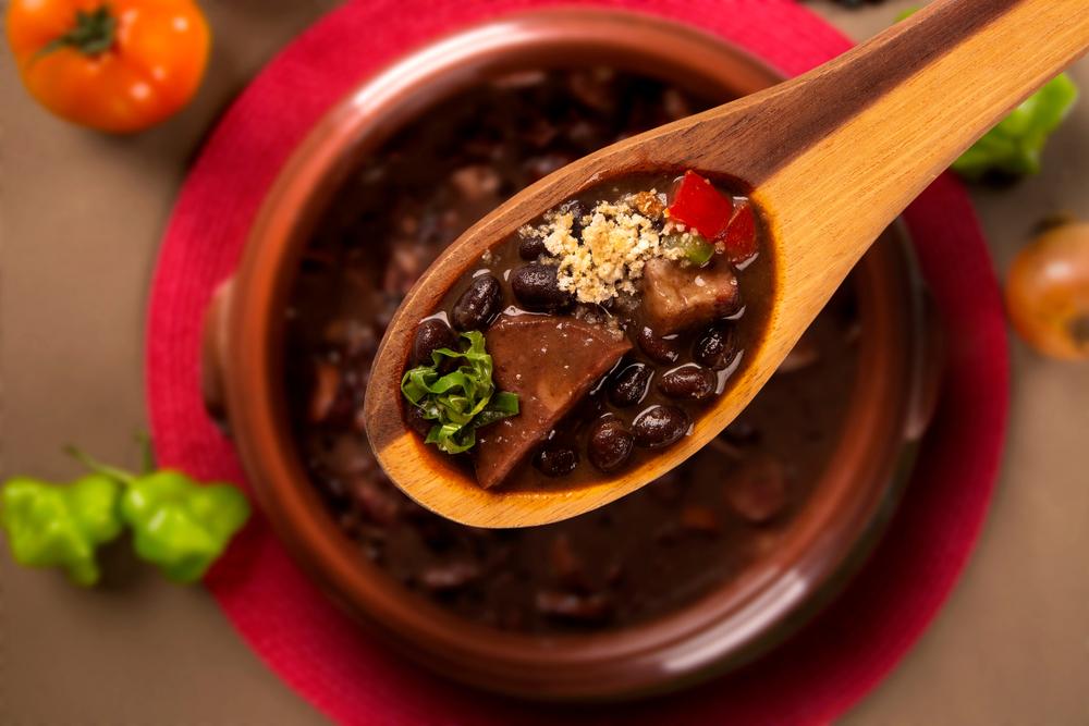 Bowl and spoon full of feijoada