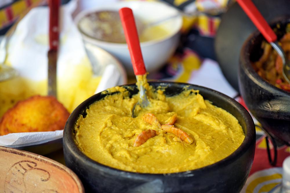 Vatapa Brazilian food in a bowl with spoon