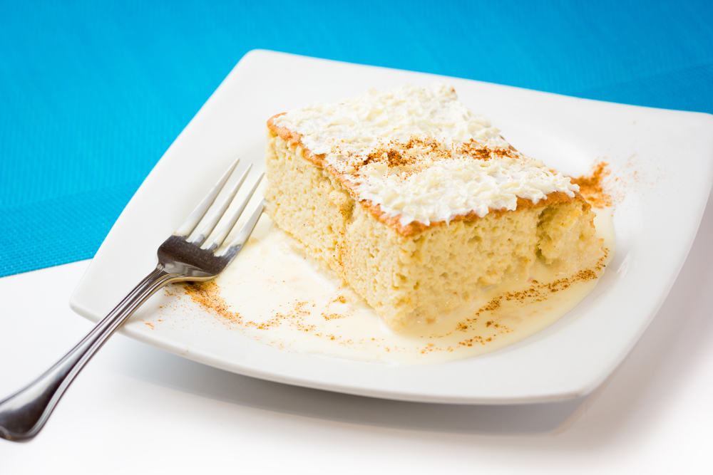 Latin Tres leches cake on white plate