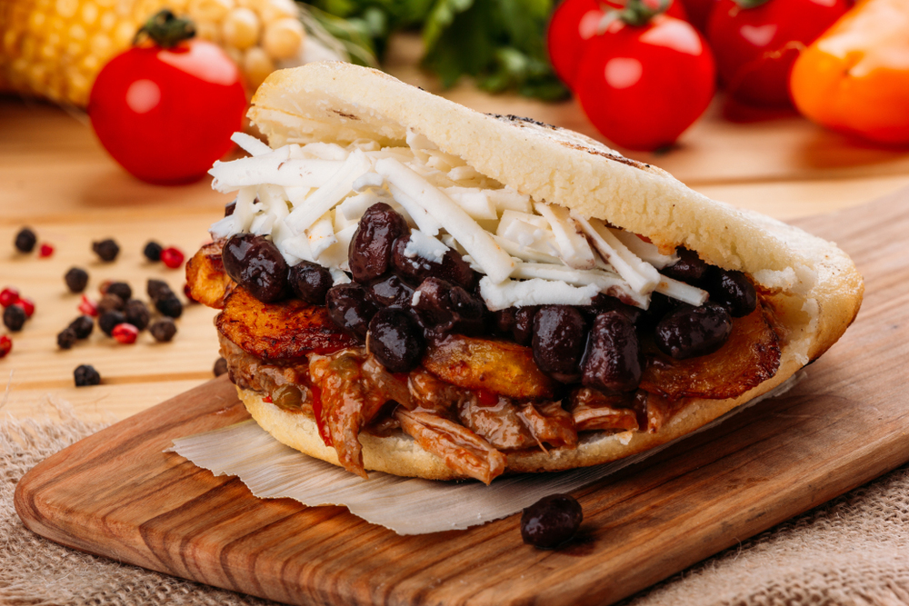Venezuelan Arepa, Pabellon, seasoned meat, fried plantain, black beans and white cheese