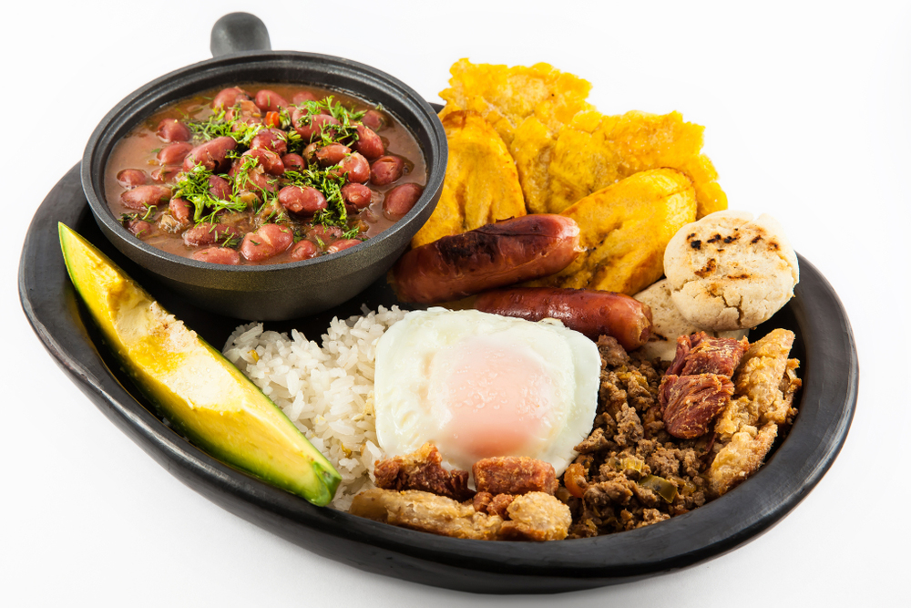 Colombian Cuisine of Bandeja Paisa on a platter on white background