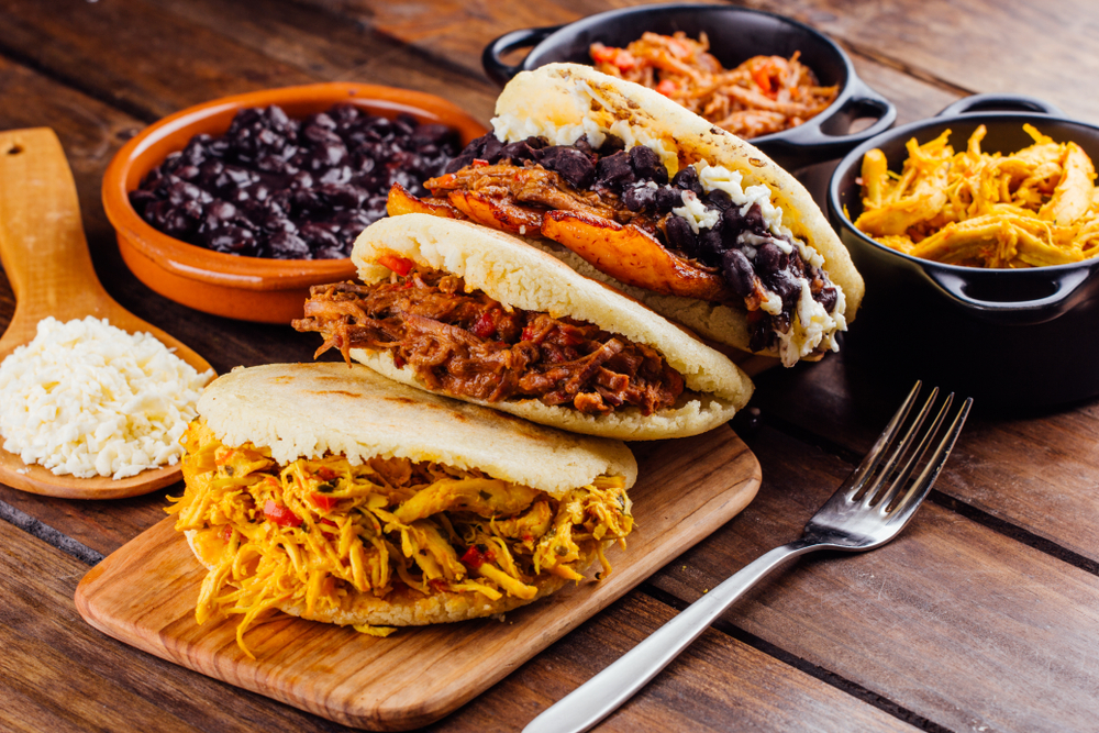 Three Colombian Arepas on wooden table
