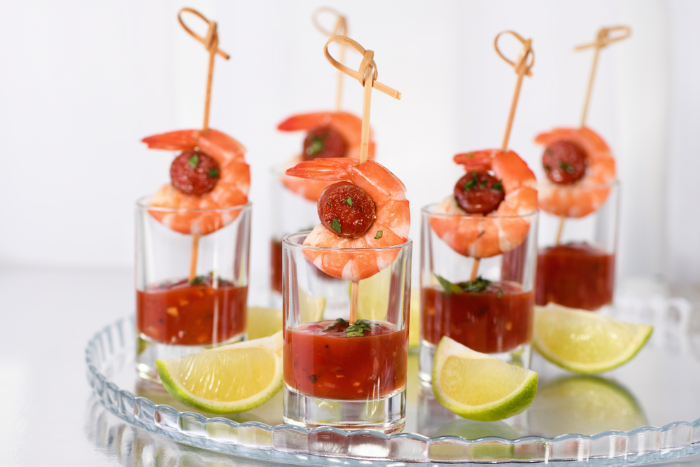 Spanish Chorizo and shrimp tapas served in a shot glass with sauce