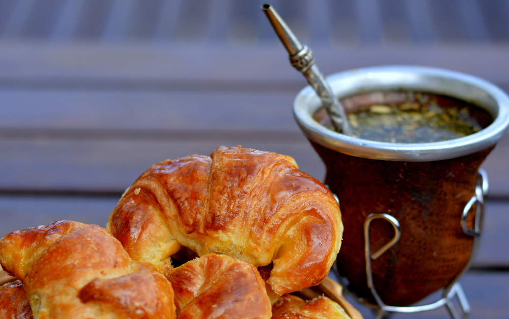 Medialunas de grasa pastry with yerba mate cup in the background
