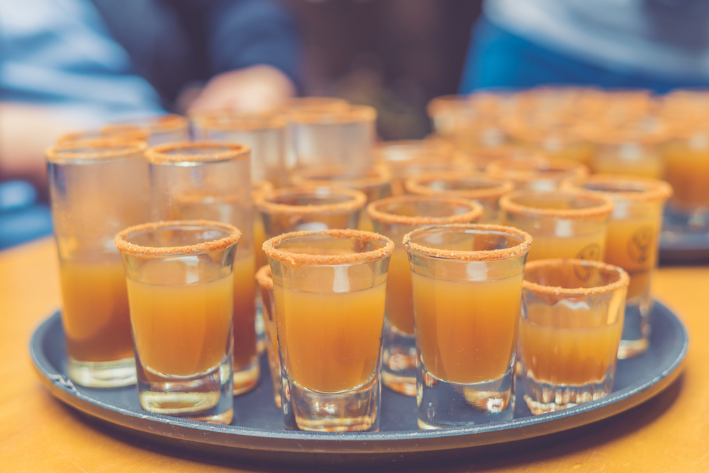 Peruvian Chicha drinks in shot glasses on a tray