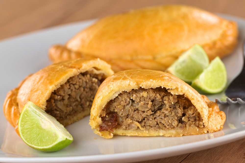 Peruvian Empanadas served with lime on white plate