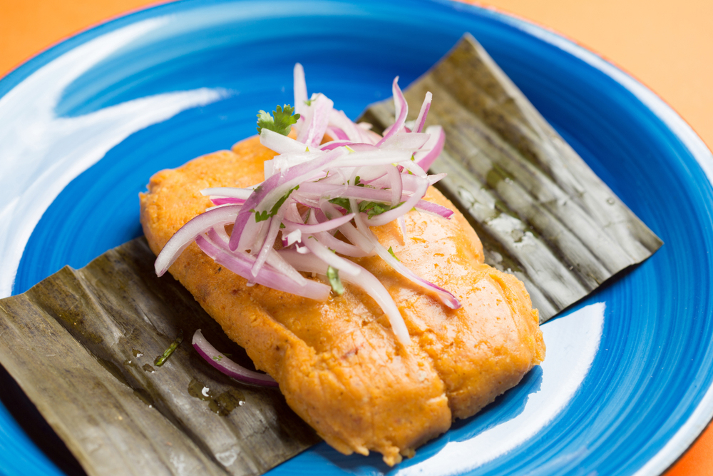 Peruvian Tamales served on a blue plate