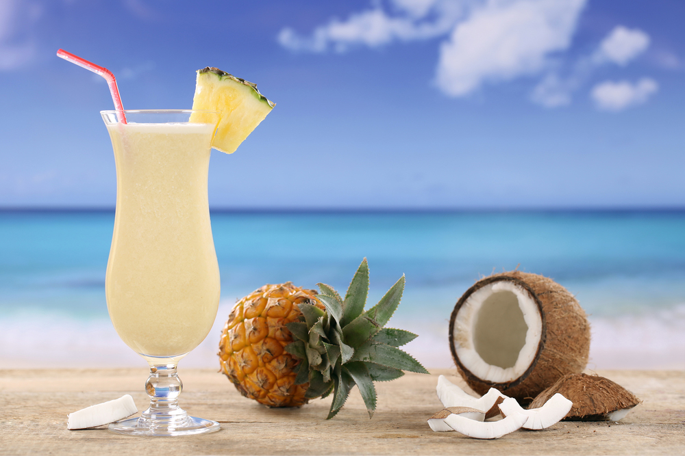 Pina Colada drink with pineapple and coconut on the beach