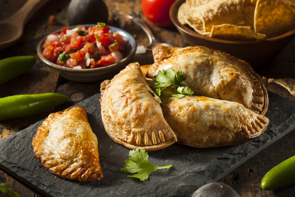 Spanish Chicken Empanadas on slate with sauce