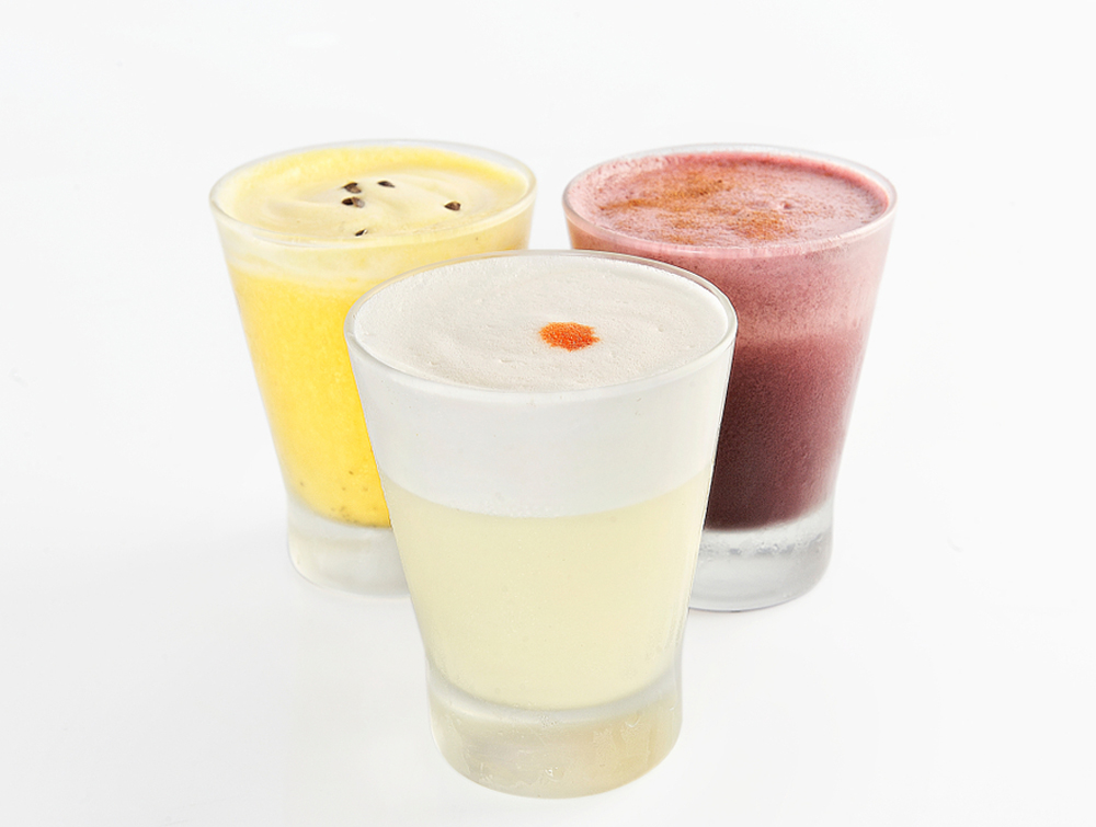 Three Different Pisco Sour Cocktails in three flavors on white background