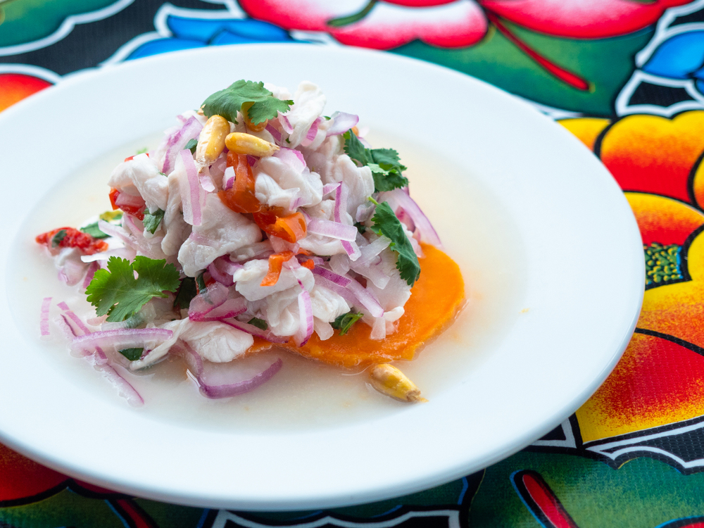 Peruvian Salad Ceviche on white plate on colorful tablecloth