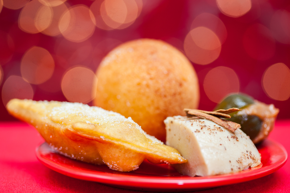 Plate of Colombian Christmas Foods with red background
