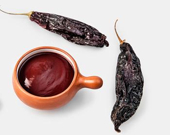 Peruvian aji panca paste and whole aji panca