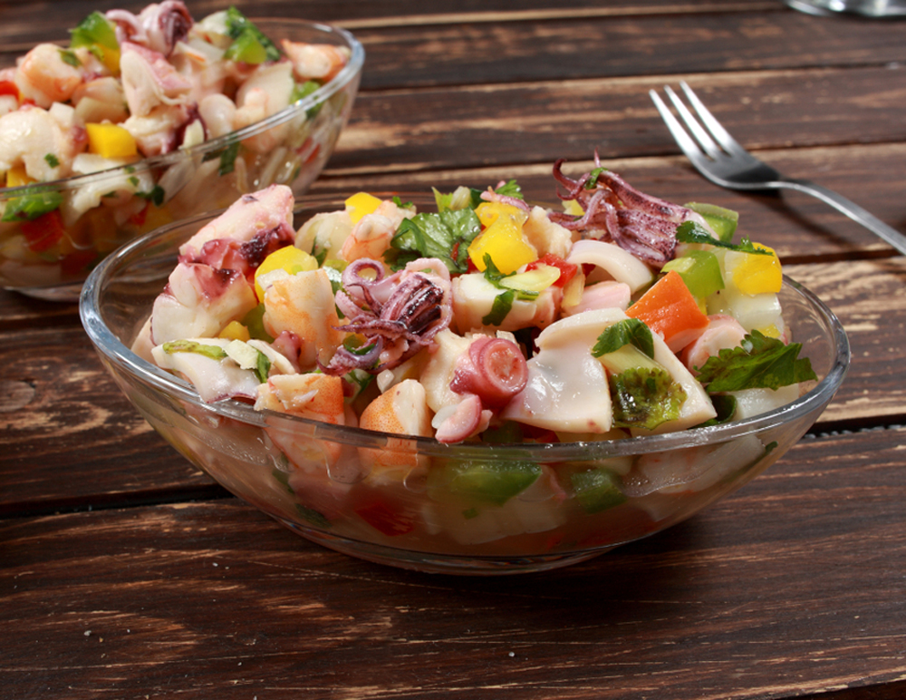 Peruvian Ceviche Salads on table with fork