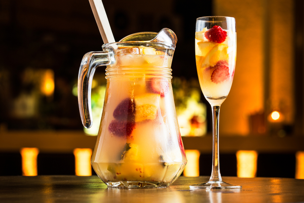Sangria de Cava in pitcher and glass on table