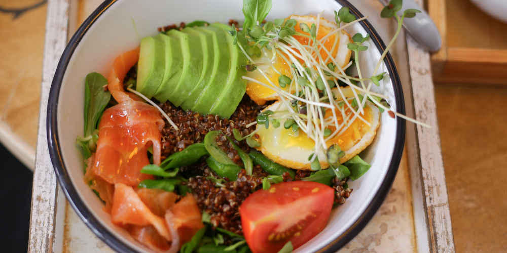 Peruvian Christmas Salad with Quinoa in bowl with avocado, tomatoes and eggs