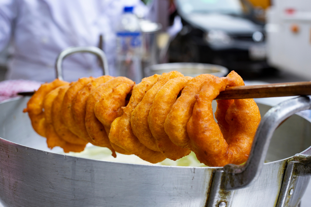Peruvian Picarones on wooden stick