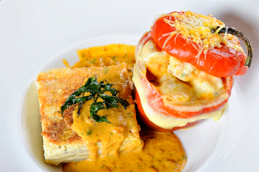 Peruvian Rocoto Relleno filled pepper with meal and cheese on white plate
