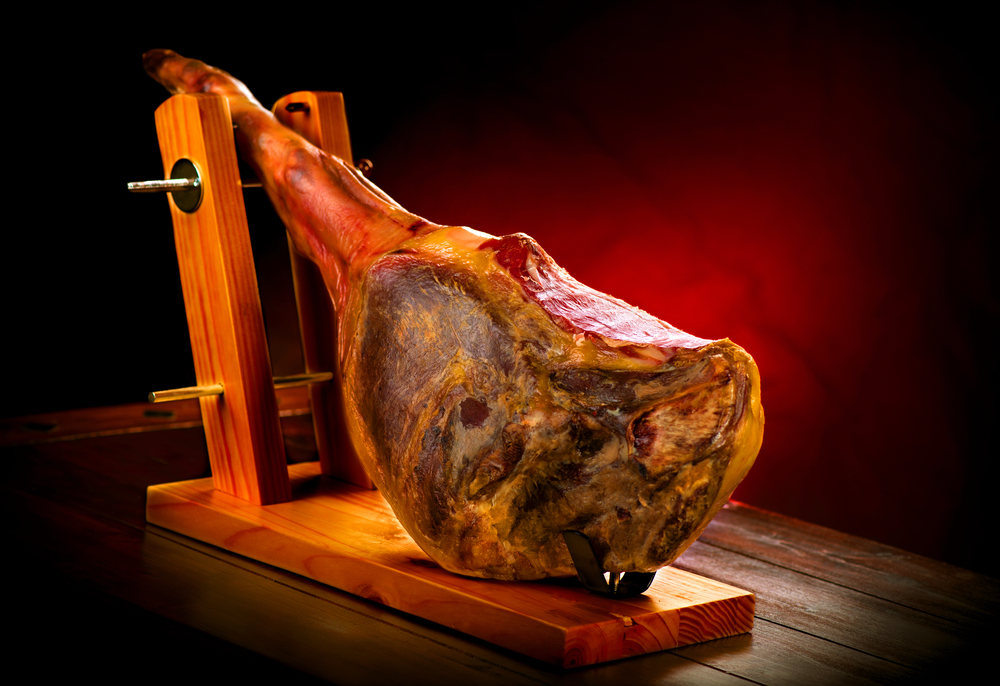 Spanish Cured Meat of Jamon in Wooden Spanish Ham Holder Jamonera