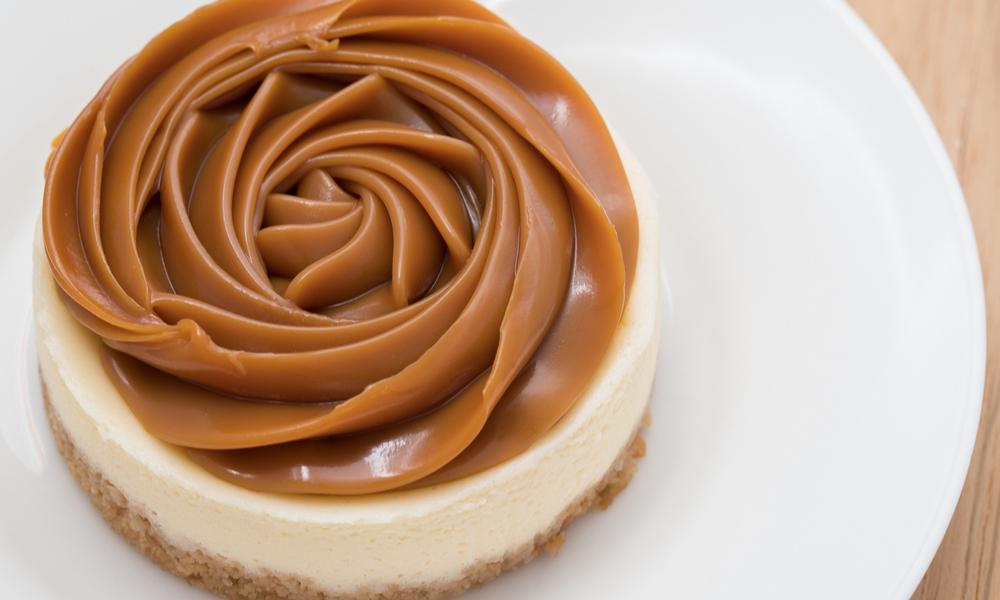 Dulce de Leche cheesecake on white plate