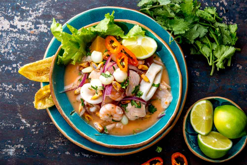 Peruvian National Dish, Ceviche served in a bowl with plantain chips and lime