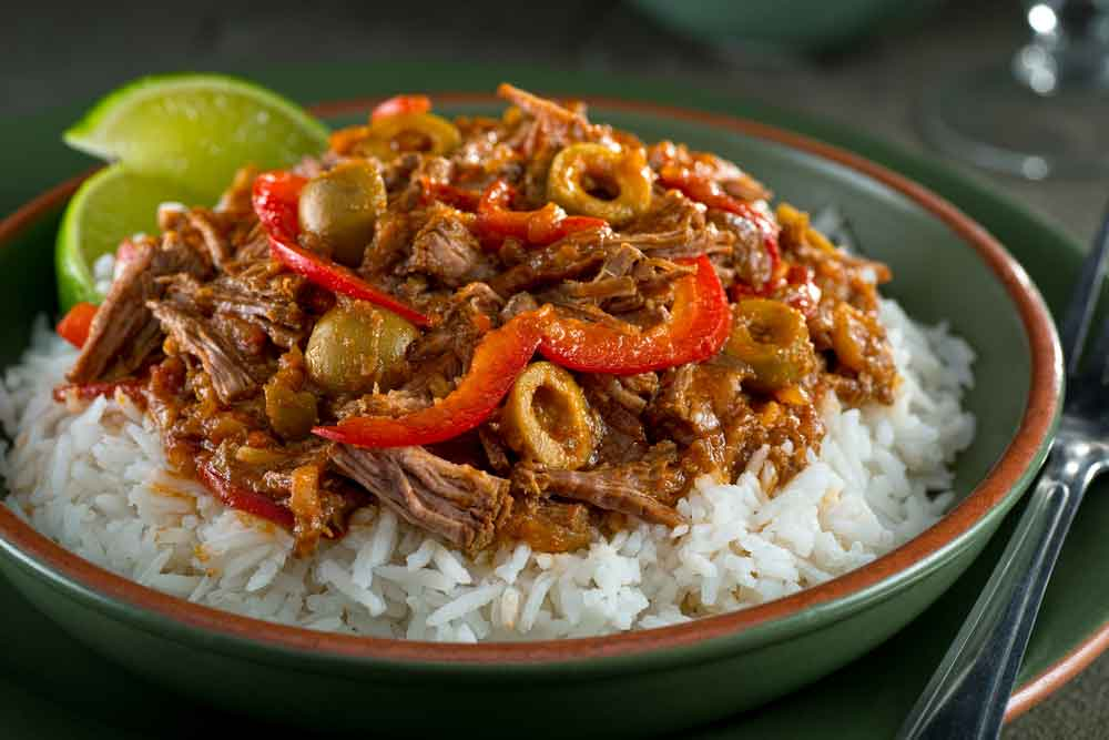 Cuban National Dish Ropa Vieja served on top of white rice