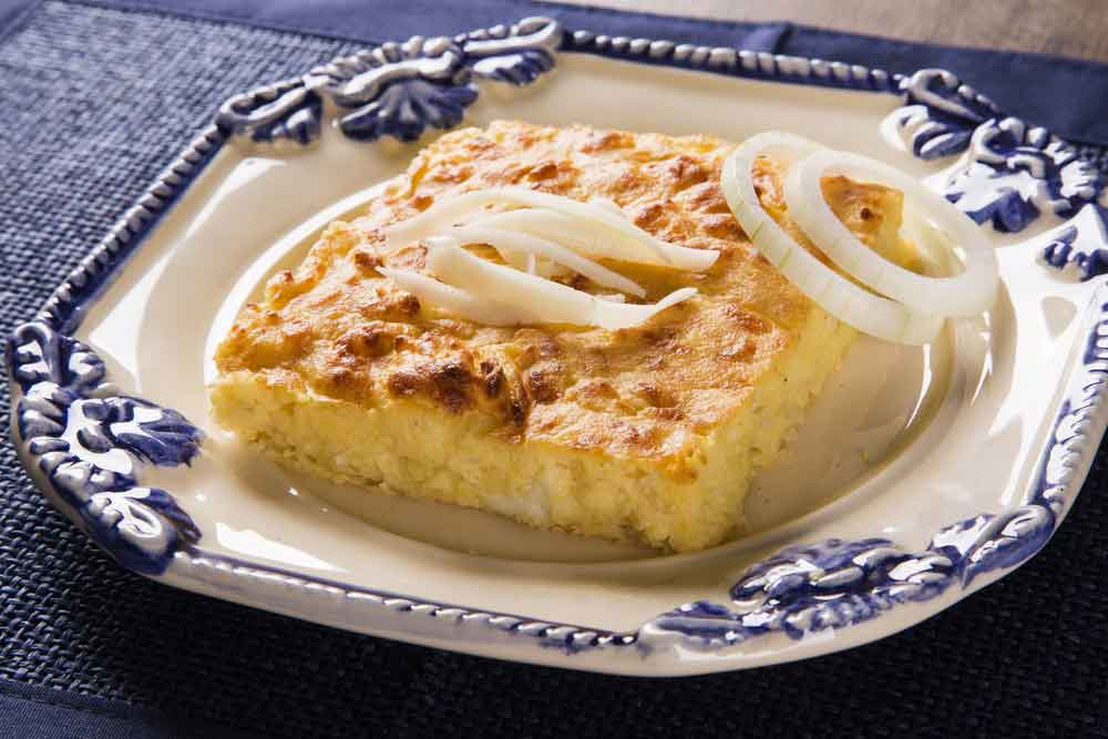 Paraguay's National Dish, Sopa Paraguaya served with onions