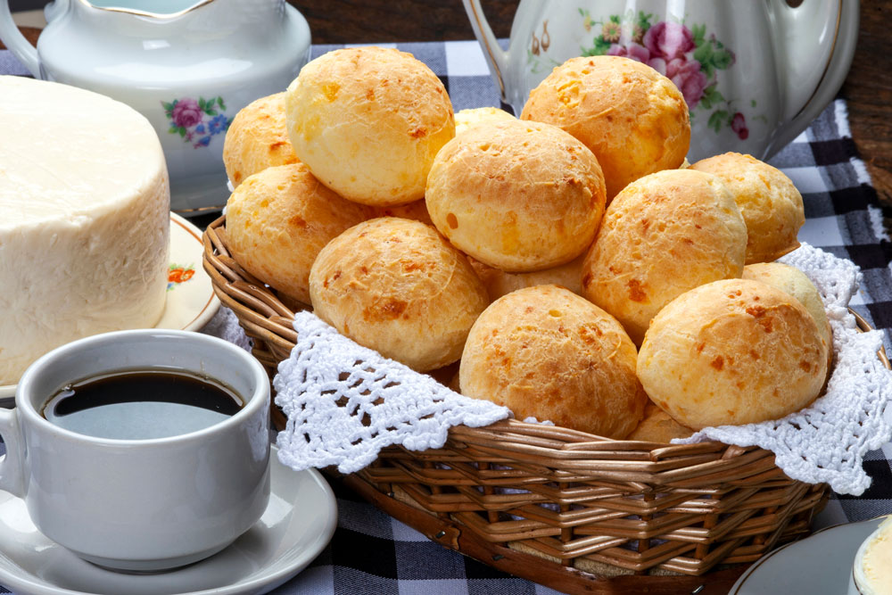 Brazilian Coffee and Brazilian cheese bread pan de queijo in a basket