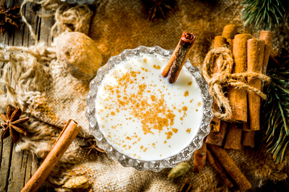 Coquito drink with cinnamon sticks