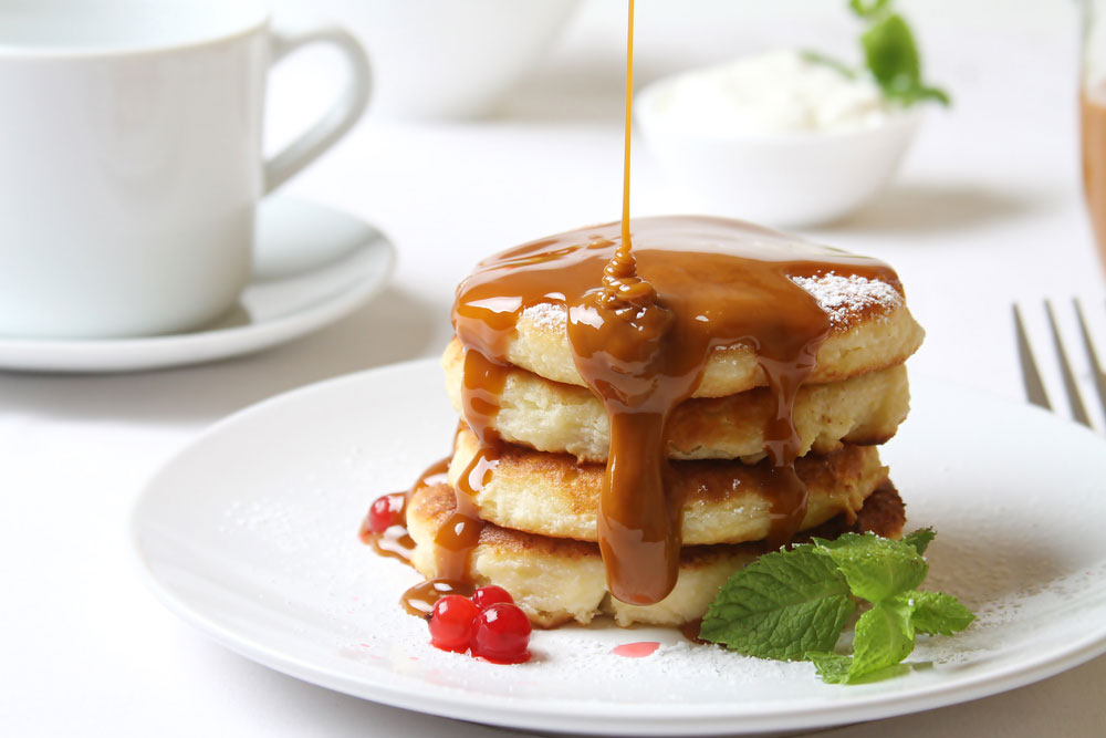 Drizzling Dulce de Leche on Pancakes