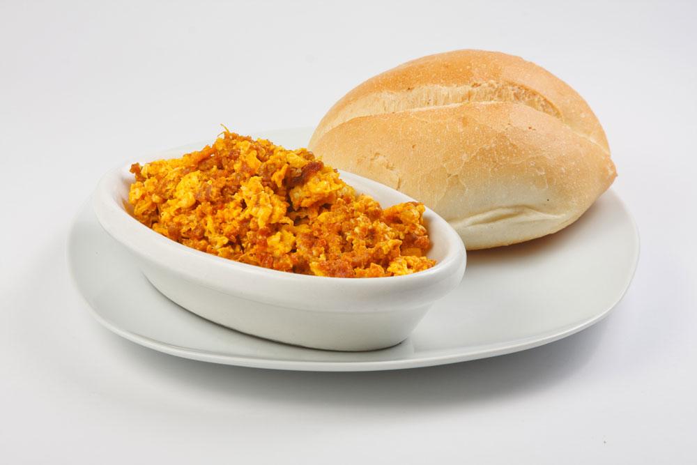 Peruvian Breakfast Dish Salchicha Huachana with bread
