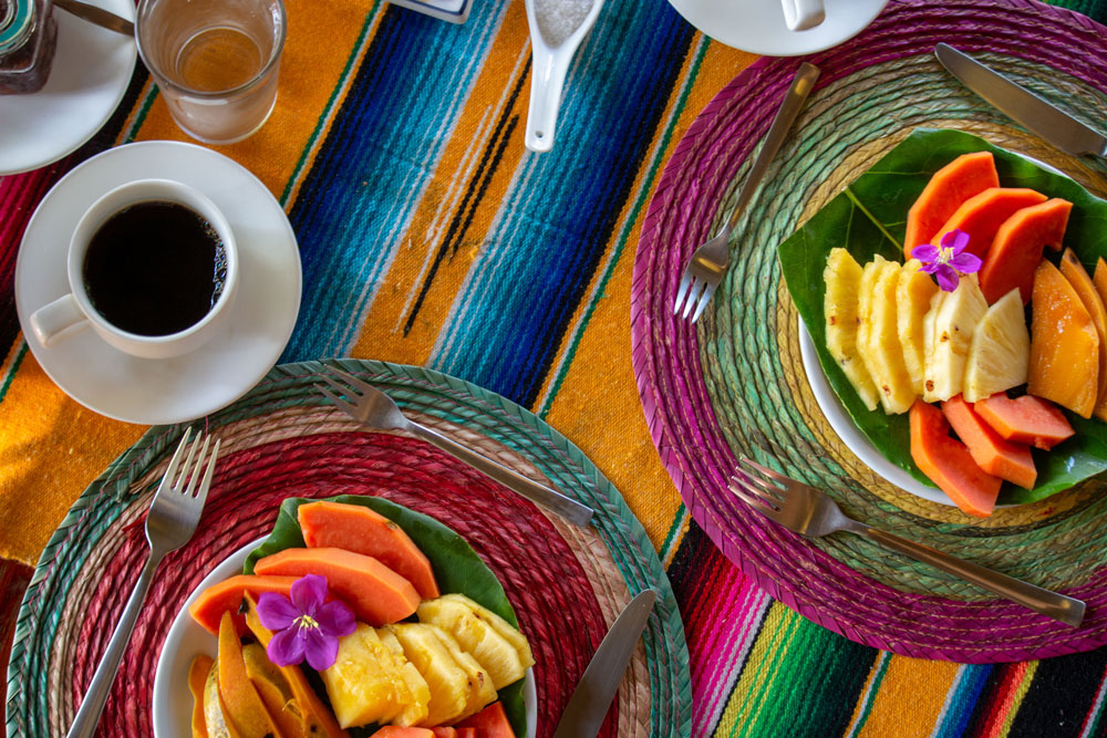 Costa Rican breakfast of fruit and coffee